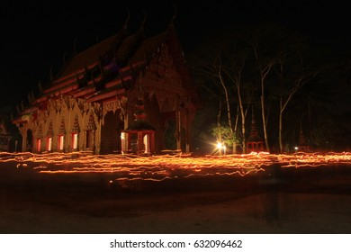 Buddhism light waving rite walk with lighted candles in hand around at Temple in Wat Tha Sung Nakhon Si Thammarat , Thailand