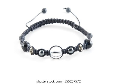 Buddhist bracelet shamballa with gems on a white background