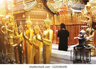 A Buddhist ceremony where people walk with lighted candles in hand around a temple at Doi Suthep - Chiang Mai, Thailand