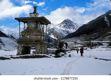 Buddhist chortens with new snow on the trail, Annapurna Himal in Nepal