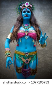 Buddhist deity: Woman with face & body paint.