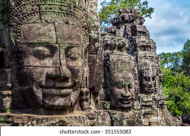 Buddhist faces on towers at Bayon Temple, Cambodia.