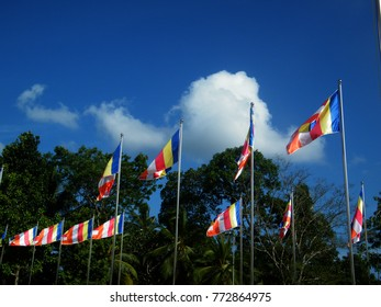 Buddhist flags against the blue sky. Buddhist flags around the bodhi tree.