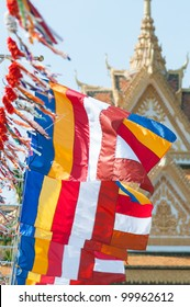 Buddhist flags at a temple in Battambang, Cambodia during Khmer New Year celebration, Chaul Chnam Thmey (Songkran). Shallow depth of field with the first flag in focus.