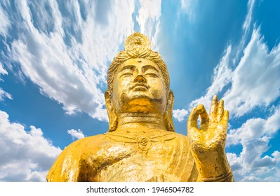 Buddhist golden bust of the statue of Kishou Kanzeon bodhisattva known as kannon bosatsu goddess of mercy making the characteristic teaching mudra gesture of Dharmachakra