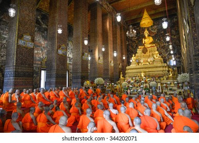 The Buddhist Lent Day at Wat Pho temple in Bankok,Thailand - 31 July 2015 Buddha image and monks in Wat pho the thai temple