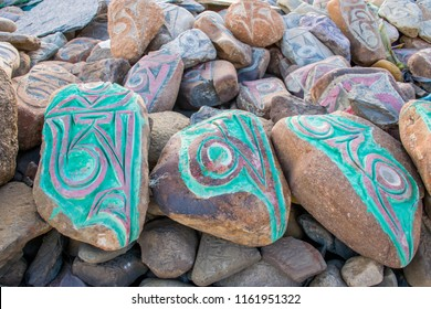The Buddhist mantra of Om Mani Padme Hum which is beaten out on a stone in mountains with the six syllables colored in the Central Tibet. Translation - Treasure in the Lotus flower. Sacred place.