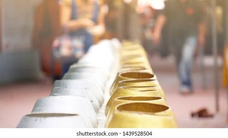 Buddhist merit making by giving alms to Buddhist important days. Blur background of Buddhist merit making on Buddhist Lent Day.
