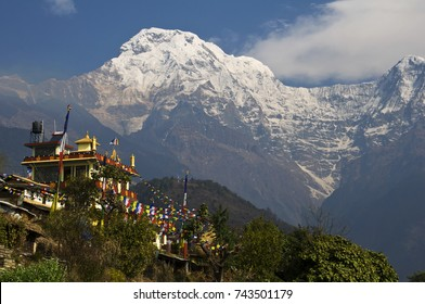 Buddhist monastery in the mountains Nepal, Pokhara, Gandryuk village: Buddhist monastery in the background of the ice-covered and snow-covered summit of Annapurna South.