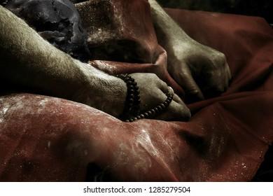 Buddhist monk hands with skull