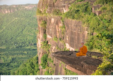 Buddhist monk in meditation at beautiful nature on high mountain