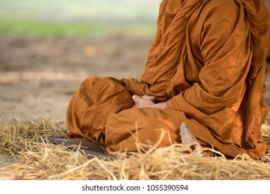 Buddhist monk in meditation pose by sitting or walking, to relax the mind with meditation concept.