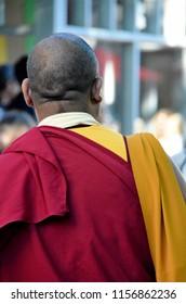 A Buddhist monk on a city street.