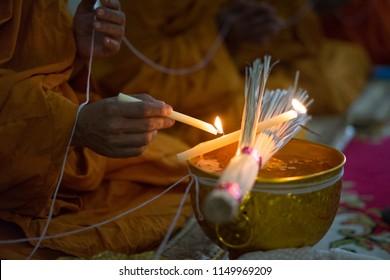 Buddhist monk praying above holy water bowl in wedding ceremony. Buddhist temple wedding ceremony ceremonies. Wedding day.