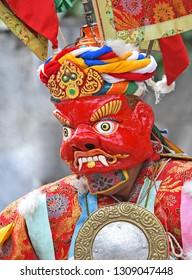 Buddhist Monk wearing colorful Holy mask at Leh, ladakh, India