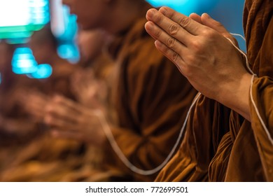 Buddhist monks put their hands together in pray