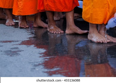 Buddhist monks walk to barefoot for clean the foot by people is culture and festival of saraburi people of Thailand.