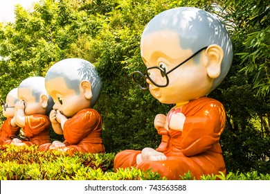 Buddhist novice dolls for Dharma puzzle, Thailand.