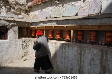 Buddhist nun turns prayer wheels
