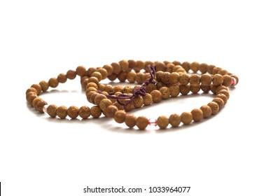 Buddhist prayer beads. 108 beads of bird cherry. Isolated on white background.