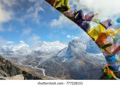 Buddhist prayer flag with Himalayas montains in Everest Base Camp Trek