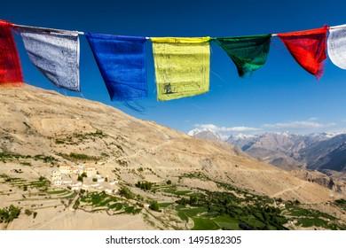Buddhist prayer flags (lungta) in sky above Spiti valley in Himalayas. Dhankar, Spiti valley, Himachal Pradesh, India