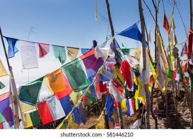 Buddhist prayer flags on a mountaintop in the Himalayas near Kanchenjunga, Nepal