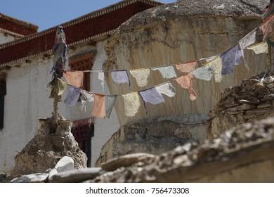 Buddhist prayer flags on an outside wall of the Lamayuru gompa monastery, Ladakh, India