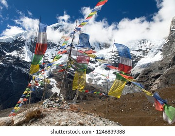 Buddhist prayer flags and Peak 7 VII, Maklu barun national park, Nepal Himalayas mountains
