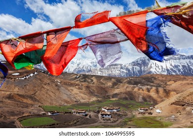 Buddhist prayer flags in sky over Comic Village. Comic Village, Spiti Valley, Himachal Pradesh, India