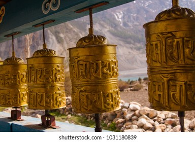 """Buddhist prayer wheel with mantra sounds """"Om mani padme hum"""", literally means 'Oh, jewel in the lotus' but has much more deeply spiritual meanings. Annapurna circuit trekking. Nepal."""