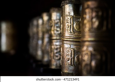 Buddhist prayer wheels in Tibetan monastery with written mantra. Temisgam monastery, Ladakh, India, Himalaya