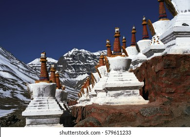 Buddhist ritual structures Stupas on the hillside of sacred Mount Kailash in Western Tibet.