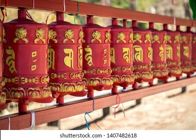 Buddhist rotating red drums with hieroglyphs