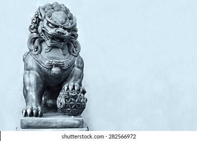 Buddhist sculpture. Guardian Lion Foo Fu dog guard. Stone statue.