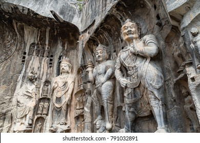 Buddhist sculptures in Fengxiangsi Cave, the main one in the Longmen Grottoes in Luoyang, Henan, China. Longmen is one of the 3 major Buddhist caves of China, and a World heritage Site.