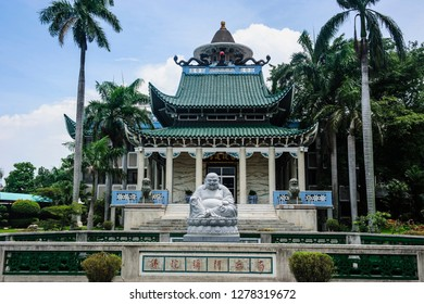 Buddhist statue before the Taoist temple in Davao, Mindanao, Philippines