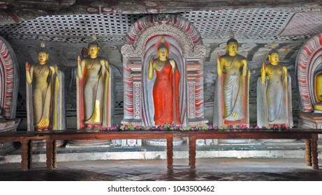 Buddhist statue in Dambulla Cave. UNESCO world heritage site in Sri Lanka, Asia. Cave temple has five ancient caves under overhanging rock and dates back to first century BC. Famous tourist attraction