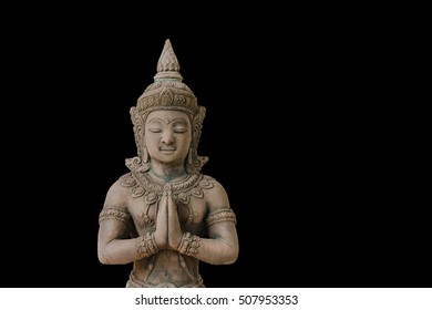 Buddhist Statue of Deity  isolated over the dark background