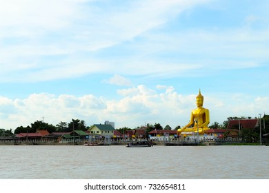 Buddhist statue on river side in Thailand