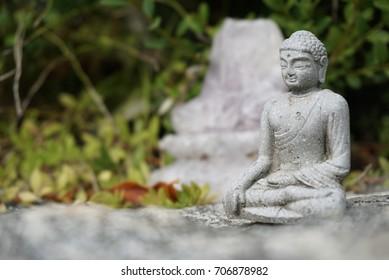 Buddhist stone statue above a stone