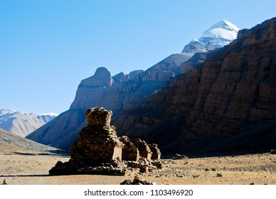 The Buddhist stupa the Enlightenment symbol on the mountain valley during the ritual kora (yatra) around sacred Mount Kailash. Ngari scenery in West Tibet. Sacred place for Buddha pupils.