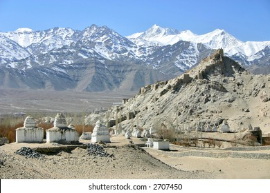 Buddhist stupas and ruins of old fort  in the Himalayas (Ladakh, Kashmir, India)