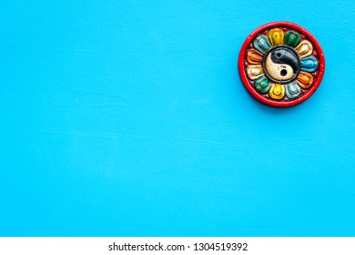 Buddhist symbol. Yin Yang symbol on blue background top view space for text