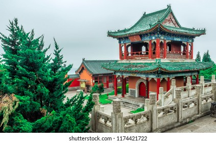 Buddhist Temple with colorful decorative details at the top of the Tianmen Mountain, Hunan Province, Zhangjiajie, China