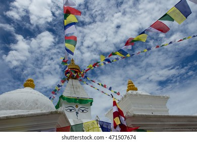 Buddhist temple with colorful flags.