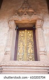 Buddhist temple door decoration in the capital of Vientiane, Laos