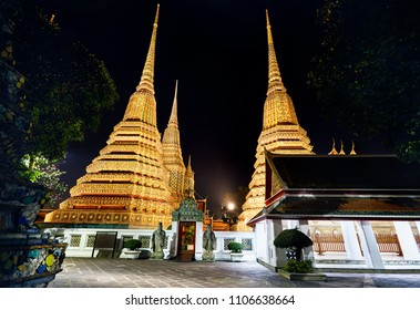 Buddhist Temple Wat Pho with golden Chedi in Bangkok at night sky in Thailand. Famous landmark and sight of the city.