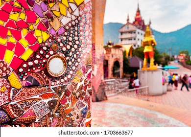 Buddhist Thailand temple Wat Phra Thart Pha Sorn Kaew with Art mosaic glass on the wall. Beautiful Landmark of Asia. Asian culture and religion