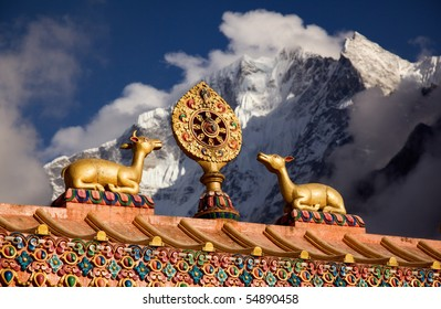 Buddhist wheel of life on the roof of a temple in Lhasa. Beautiful light in sunset.